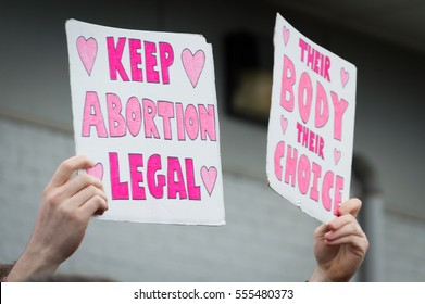 BELLINGHAM, WASHINGTON, USA - November 20, 2015: Male hands holding pro choice signs during a demonstration in support of Planned Parenthood after the election.