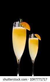 Bellini, a cocktail with Prosecco or champagne, white peaches and sugar syrup, in a pop contemporary style. Dark background.