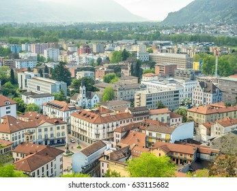 Bellinzona cityscape view from castle under cloudy blue sky in Switzerland, surrounding with high Alps mountains