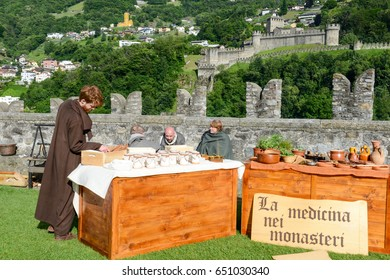 Bellinzona, Switzerland - 21 May 2017: people selling medicinal herbs at the medieval market on Castelgrande castle at Bellinzona on the Swiss alps
