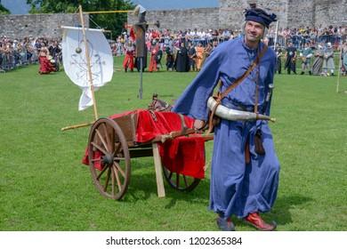 Bellinzona, Switzerland - 27 May 2018: people walking during a parade of medieval characters on Castelgrande castle at Bellinzona on the Swiss alps