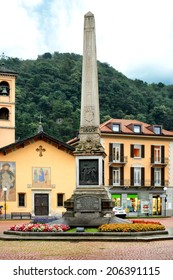 BELLINZONA, SWITZERLAND - JULY 4, 2014: Piazza Indipendenza, Bellinzona. Formerly Piazza San Rocco, takes its name from the obelisk in the center erected to mark the centenary of the Act of Mediation.
