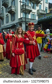 """Bellinzona, Switzerland - March 2nd 2019: Big crowd for the traditional """"Guggen"""" marching bands parade at the Rabadan Carnival 2019 in Bellinzona, Tessin"""