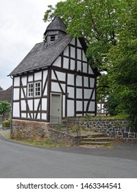 Bellnhausen, Hesse/Germany - July 27, 2019: Half-timbered chapel in a small village