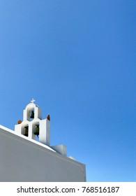 Bells against Santorini Skyline