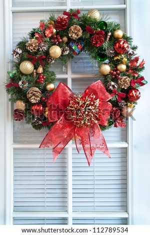 bells balls shells colored pine cones tiny red bows and a big - Christmas Decorations With Large Pine Cones