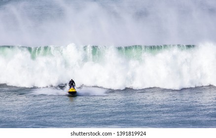 Bells Beach, Torquay/Australia – April 27, 2019:  A jet ski aiding pro surfers competing at Rip Curl Pro is avoiding breaking swells