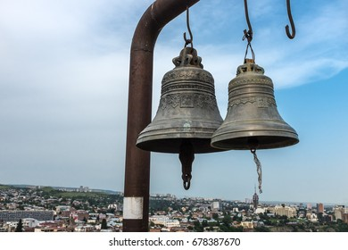 Bells located on the walls of the ancient ruins of Narikala Fortress overlooking the city of Tbilisi, Georgia, Eastern Europe.