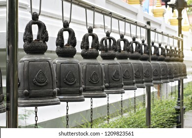 Bells old vintage many close-up In the temple Buddhism at Thailand.