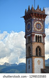 Belltower with clock of the Church of St Sebastian in Cavalese, Trentino, Italy