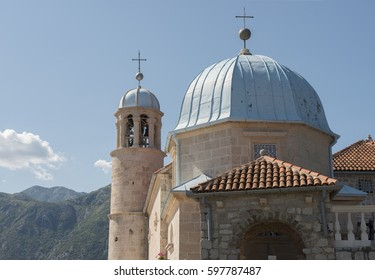 Bell-tower of Our Lady of the Rocks Church on manmade islet near Perast, Kotor bay, Montenegro.