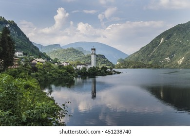 Belluno, Italy - 9 July 2016:  View of the Lake of Corlo located near the small villages of Rocca and Arsie, in the Dolomite Mountains of Belluno, Italy