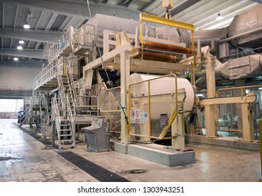 BELLUNO, ITALY - February 27, 2017 - This paper mill is a factory devoted to making paper and coated cardboard from recycled paper using this Fourdrinier machine.