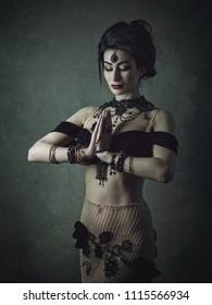 Belly Dancer. Ethno styled female portrait with oriental bijou