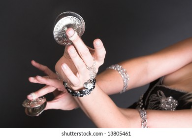 Belly Dancer hands holding Tribal Zagat or finger symbols