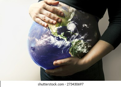 Belly with earth of pregnant woman on brown background. Elements of this image furnished by NASA