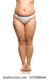 Belly, legs and waist of overweight woman on white background