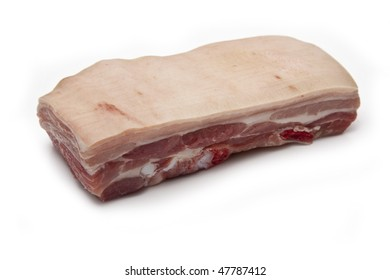 belly pork uncooked isolated on a white studio background.