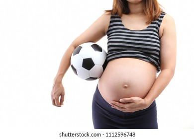 belly of a pregnant woman with soccer ball isolated