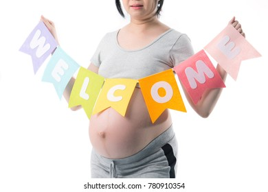 A belly of pregnant woman with welcome banner on the white background.