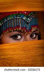Bellydancer peeking from behind her veil