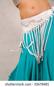 belly-dancer in traditional white and turquoise costume