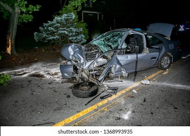 Belmont, MA / USA - June 13, 2015: A serious one-car traffic accident involved a collision with a tree and resulted in serious personal injury