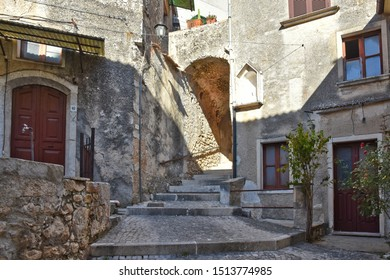 Belmonte, Italy, 09/21/2019. A narrow street among the old houses of a medieval village.