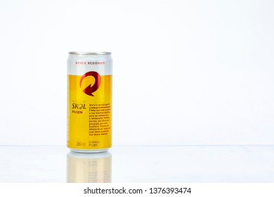 BELO HORIZONTE, BRAZIL - APRIL 19, 2019: Skol pilsen beer can background isolated on white, Skol is the most popular beer in Brazil, Lager chopp pilsen Brasileira, 269ml