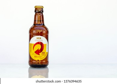BELO HORIZONTE, BRAZIL - APRIL 19, 2019: Skol pilsen beer bottle background isolated on white, Skol is the most popular beer in Brazil, Lager chopp pilsen Brasileira, 300ml,