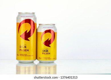 BELO HORIZONTE, BRAZIL - APRIL 19, 2019: Skol pilsen beer two can background isolated on white, Skol is the most popular beer in Brazil, Lager chopp pilsen Brasileira, 473ml and 350ml
