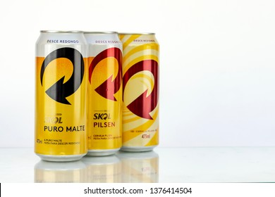 BELO HORIZONTE, BRAZIL - APRIL 19, 2019: Skol pilsen beer and pure malt three can background isolated on white, Skol is the popular beer in Brazil, Lager chopp pilsen and puro malte Brasileira, 473ml