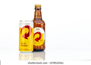 BELO HORIZONTE, BRAZIL - APRIL 19, 2019: Skol pilsen beer can background isolated on white, Skol is the most popular beer in Brazil, Lager chopp pilsen Brasileira 300ml and 269ml
