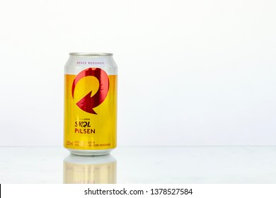 BELO HORIZONTE, BRAZIL - APRIL 19, 2019: Skol pilsen beer can background isolated on white, Skol is the most popular beer in Brazil, Lager chopp pilsen Brasileira, 350ml