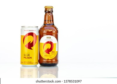 BELO HORIZONTE, BRAZIL - APRIL 19, 2019: Skol pilsen beer can and bottle background isolated on white, Skol is the most popular beer in Brazil, Lager chopp pilsen Brasileira, 300ml and 269ml