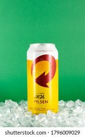 BELO HORIZONTE, BRAZIL - AUGUST 08, 2020: Skol pilsen beer can background isolated on white, Skol is the most popular beer in Brazil, Lager chopp pilsen Brasileira, 473ml