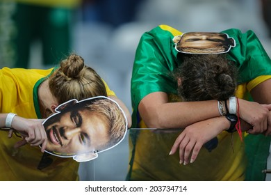 BELO HORIZONTE, BRAZIL - July 8, 2014: Brazil fans in shock and tears after Germany 7x1 win against Brazil during the World Cup Semi-finals at Mineirao Stadium. NO USE IN BRAZIL.