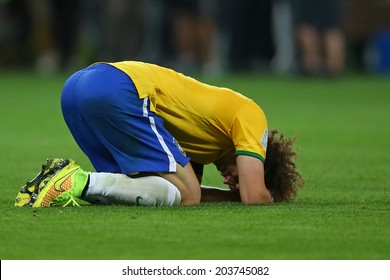 BELO HORIZONTE, BRAZIL - July 8, 2014: Germany defeats Brazil 7x1 and David Luiz cries on the field of Mineirao Stadium. NO USE IN BRAZIL.