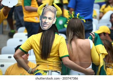 BELO HORIZONTE, BRAZIL - July 8, 2014: Brazil soccer fans celebrating at the 2014 World Cup Semi-finals game between Brazil and Germany at Mineirao Stadium. NO USE IN BRAZIL