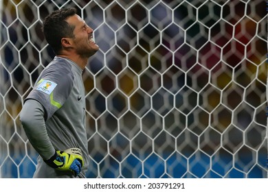 BELO HORIZONTE, BRAZIL - July 8, 2014: Julio Cesar of Brazil devastated during the 2014 World Cup Semi-finals game between Brazil and Germany at Mineirao Stadium. NO USE IN BRAZIL.