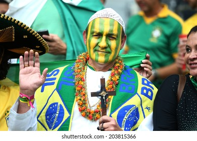 BELO HORIZONTE, BRAZIL - July 8, 2014: Soccer fan of Brazil during the World Cup Semi-finals game between Brazil and Germany at Mineirao Stadium. NO USE IN BRAZIL.