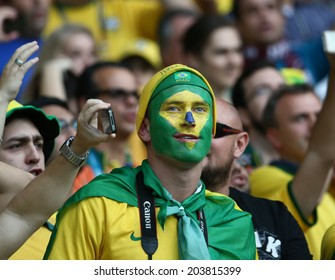 BELO HORIZONTE, BRAZIL - July 8, 2014: Soccer fan of Brazil at the World Cup Semi-finals game between Brazil and Germany at Mineirao Stadium. NO USE IN BRAZIL.