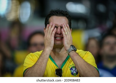 BELO HORIZONTE, BRAZIL - July 8, 2014: Brazil fans in shock during the successive goals scored by Germany during the World Cup Semi-finals at Mineirao Stadium. NO USE IN BRAZIL.