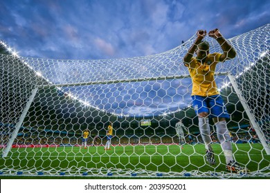BELO HORIZONTE, BRAZIL - July 8, 2014: Brazilian player shows his disappointment after Germany defeated Brazil 7x1 during the 2014 World Cup Semi-finals game at Mineirao Stadium. NO USE IN BRAZIL.