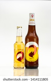 BELO HORIZONTE, BRAZIL - JUNE 01, 2019: Skol pilsen beer opens easy two bottle background isolated on white, Skol is the most popular beer in Brazil, Lager chopp pilsen Brasileira, 600ml and 275ml