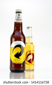 BELO HORIZONTE, BRAZIL - JUNE 01, 2019: Skol Pure Malt and pilsen beer opens easy two bottle background isolated on white, Skol is the most popular beer in Brazil, Lager chopp Brasileira, 600ml 275ml