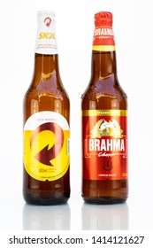BELO HORIZONTE, BRAZIL - JUNE 01, 2019: Skol and Brahma pilsen beer two bottle background isolated on white, Skol and Brahma is the competing most popular beers in Brazil, Lager chopp Brasileira 600ml