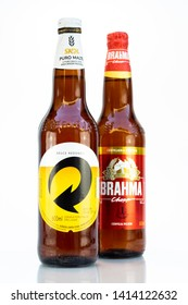 BELO HORIZONTE, BRAZIL - JUNE 01, 2019: Brahma pilsen and Skol Pure Malt beer two bottle background isolated on white, Skol and Brahma is the competing most popular chopp beers in Brazil, 600ml