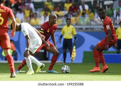 BELO HORIZONTE, BRAZIL - June 17, 2014: Vincent KOMPANY of Belgium kicks the ball during the 2014 World Cup Group H game between Belgium and Algeria at Mineirao Stadium.
