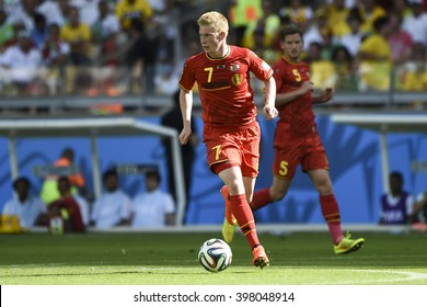 BELO HORIZONTE, BRAZIL - June 17, 2014: Kevin DE BRUYNE of Belgium compete for the ball during the World Cup Group H game between Belgium and Algeria at Mineirao Stadium.